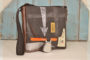 Unisex, cross-body, messenger bag, showcases, multi-functional use, multi-mixed media combinations, decommissioned natural rubber, liferaft, leather, cotton-webbing strap, upcycled, upcycled materials, hardwearing, weather resistant, errands bag, office bag, overnight bag, documents, devices, 15 vinyl's and a few 45s, Dj, Dj bag, Dj messenger, bros, edition, cool, cool bag, unique, grunge, style features, charcoal black, orange, silver, matt black finish, weathered, UV filter, Hugo Boss sail, Mamukko, leather, closed shoe factory, emergency inflatable life vests, rubber, liferaft, hands, materials, distinctive, craft, experimented, unwanted materials, repurposed, toughest, most advanced technical, scientific cloth, examined, diverse, extreme weather conditions, Professional yacht racing, endurance tests, design, human resilience, acute extremes, Mamukko family, Pioneers of their craft, tested to human endurance, physically work by hand, carbon fibre, transforming, sail, high-end, functional, heirloom, art piece, respect, Hugo Boss Sail, imoca 60, monohull race, Extremely Collectable, Exclusive, mamukko, brothers, kinsale, Ireland, awards, sustainable, eco friendly, landfill, rescue, upcycled, upcycle, remnants, diverse, cool, documents, devices, vinyl's', records, albums, 45 singles, designed, DJ, grunge style, features, sails, repurposed, grunge, style, features, special sections, divese selections,