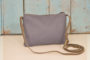 One bird pocket back made from navy airplane seat leather rectangular shape long thin strap