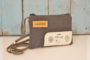 One bird pocket bag front made with natural decommissioned rubber liferaft back is made with airplane seat leather rectangular shape long thin strap